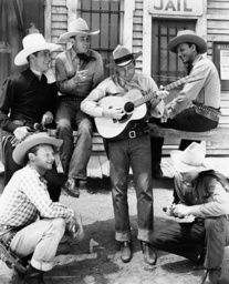 Bob Nolan (center on guitar) and the Sons of the Pioneers in one of their western movie appearances,
