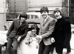 Paul Mccartney And John Lennon Give A Thumbs Up After Lennon Passed His Driving Test Fellow Beatles George Harrison And Ringo Starr Are Also Pictured Celebrating His Success.