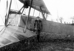 Fighter pilot next to his plane, 1914