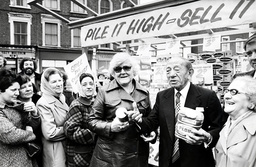 Sir John Cohen (1898-1979) Founder Of The Tesco Supermarket Chain. Pictured Outside His Store In Well Street Hackney Selling Tinned Goods From A Stall. This Is The Place Where He Started His Business Career. (sir Jack Cohen).