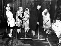 Comedian Tommy Cooper (died April 1984) Pictured Helping To Clean Up The Fire Damaged Stage At Manchester's Palace Theatre.