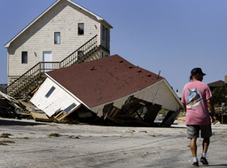 PART OF A BEACHFRONT HOME LAYS WRECKED AT SOUTH NAGS HEAD AFTER HURRICANE ISABEL