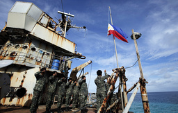 Marines, members of a military detachment stationed aboard the BRP Sierra Madre, take part in a flag retreat on the ship, at disputed Second Thomas Shoal, part of Spratly Islands, in South China Sea