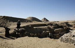 Workers carry out restoration work at the site of a recently discovered pyramid in Saqqara