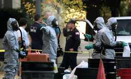 MILITARY PERSONNEL HANDLE BIOHAZARD BAG NEAR CONGRESSIONAL OFFICE BUILDING