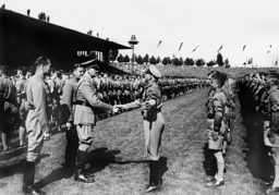 Rudolf Hess, Baldur von Schirach and Adolf Hitler at the Hitler Youth's roll call on the Nuremberg Rally, 1936