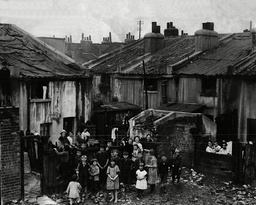 An Evening News Photograph Showing London Slums In 1925. Picture Shows The Corner Of Dupont Street Limehouse The Roofs Are Covered To Keep Out The Rain And The Houses Have No Windows.
