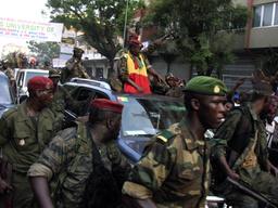 Captain Moussa Dadis Camara waves as he tours Conakry