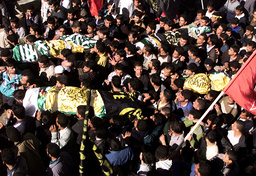 PALESTINIANS CARRY THE BODIES OF FOUR DEAD PALESTINIANS IN GAZA STRIP