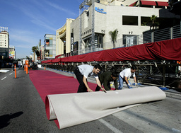 WORKERS ROLL OUT RED CARPET ON HOLLYWOOD BLVD FOR OSCARS