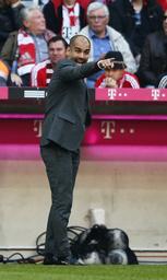 Munich's Guardiola gestures during their German first division Bundesliga soccer match against Hoffenheim in Munich