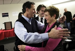 Republican presidential candidate Santorum hugs a supporter as he campaigns in Orange City