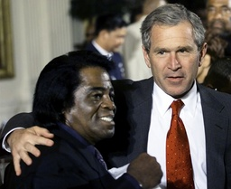 File photo of US President Bush talks with music legend James Brown in Washington