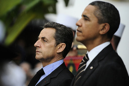 France's President Sarkozy and US President Obama pay their respect after laying a wreath by the monument dedicated to War victims in Cannes