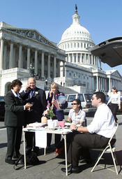 MEMBERS OF CONGRESS WORK ON THE GROUNDS OF THE CAPITOL
