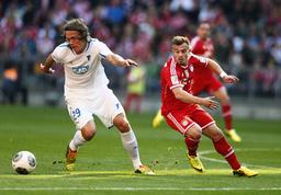 Bayern Munich's Shaqiri challenges 1899 Hoffenheim's Vestergaard in German first division Bundesliga soccer match in Munich