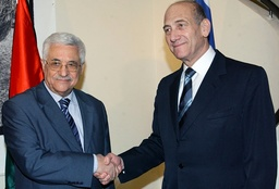 Israel's Prime Minister Olmert and Palestinian President Abbas shake hands in Jerusalem
