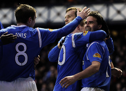 Rangers' Healey celebrates with Davis during their Scottish Premier League soccer match against Motherwell in Glasgow