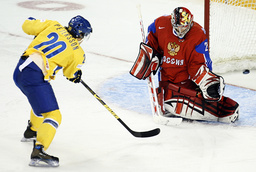 Sweden's Petersson is blocked by Russia's Alistratov on a scoring attempt at the IIHF U20 World Junior Hockey Championships in Ottawa