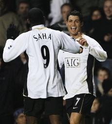 Manchester United's Ronaldo celebrates his goal against Aston Villa with Saha during their English Premier League match in Birmingham