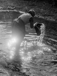 Genre Photo – Woman Washing Clothes in a Stream