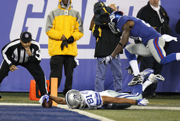 Cowboys Robinson dives into the endzone past Giants Kenny Phillips for touchdown