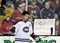 Montreal Canadiens Sheldon Souray warms up in front of a sign wishing the team 'Merry Christmas' in Boston