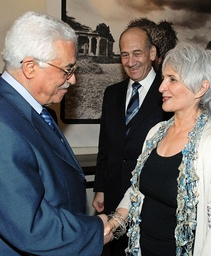 Palestinian President Mahmoud Abbas shakes hands with Eliza Olmert, as her husband Israeli PM Ehud Olmert watches at Prime Minister's Jerusalem residence