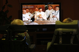 Christmas mass on TV in an elderly persons' home