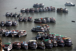 Ferries used to transport people, mainly tourists, are parked in the Arabian Sea in Mumbai