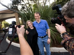 European Space Agency astronaut Christer Fuglesang, with his wife Elisabeth, poses for Swedish photographers after a news conference in Cocoa Beach
