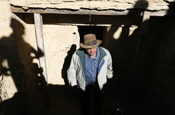 Egypt's antiquities chief Hawass steps out of one of the two recently discovered tombs in Saqqara
