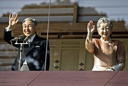 Japan's Emperor Akihito waves with Empress Michiko to well-wishers as he celebrates his 73rd birthday at the Imperial Palace in Tokyo