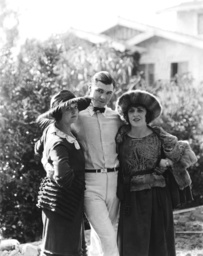 From left, Rosemary Theby, Jack Dempsey, Ruth Roland, on the Pathe lot, where Dempsey is filming DAR