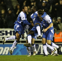 Wigan Athletic's Heskey celebrates with team mates after scoring during their English Premier League soccer match against Chelsea in Wigan