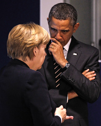 Germany's Chancellor Merkel and U.S. President Obama discuss before a meeting on the second day of the G20 Summit in Cannes