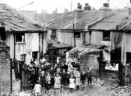 London Slums In 1925. Picture Shows The Corner Of Dupont Street Limehouse The Roofs Are Covered To Keep Out The Rain And The Houses Have No Windows.
