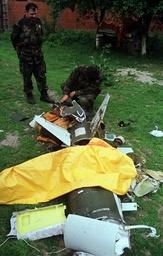 YUGOSLAV ARMY SOLDIERS EXAMINE UNMANNED NATO SURVEILLANCE DRONE IN LIPLJAN