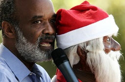 Haiti's President Rene Preval uses a Santa Claus while addressing a children's Christmas gathering at the national palace in Port-au-Prince