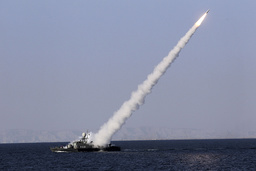 New medium-range missile is fired from naval ship during Velayat-90 war game on Sea of Oman near Strait of Hormuz in southern Iran