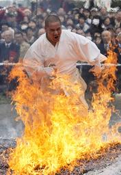 An ascetic Buddhist monk runs through flames during the Nagatoro Fire Festival in Nagatoro town