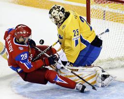 Russia's Filatov slides into Sweden's Markstrom on a scoring attempt at the IIHF U20 World Junior Hockey Championships in Ottawa