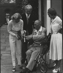 Sir Victor Sassoon Gives His Camera To His Nurse (wife Lady Evelyn Sassoon) As Former Aviator Charles Hughesdon And His Wife Film Star Florence Desmond Look On. Box 0598 25062015 00294a.jpg.