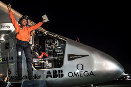 Swiss pilot Bertrand Piccard reacts after landing Solar Impulse 2, a solar-powered plane, on Moffett Airfield in Mountain View, California