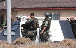 SWAT TEAM MEMBERS DEPART SCENE OF WILLIAMS SISTER FATAL SHOOTING