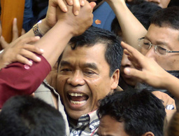Former deputy chief of Indonesia's National Intelligence Agency Purwoprandjono reacts after his trial in south Jakarta court