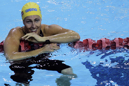 Sweden's Therese Alshammar smiles after winning the women's 100m butterfly final during the FINA Swimming World Cup in Singapore