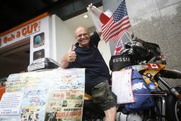 Vladimir Yarets poses with his motorbike in Singapore