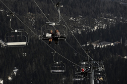 Electoral committee members Srebalova and Vincova ride a chairlift while carrying a mobile ballot box to reach a chalet below Solisko peak during the run-off presidential in the High Tatras