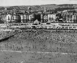 An Aerial View Of Brighton Showing A Packed Beach